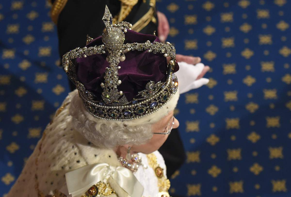 Queen Elizabeth II proceeds through the Royal Gallery after she addressed the State Opening of Parliament in the House of Lords at the Palace of Westminster on May 18, 2016 in London, England.