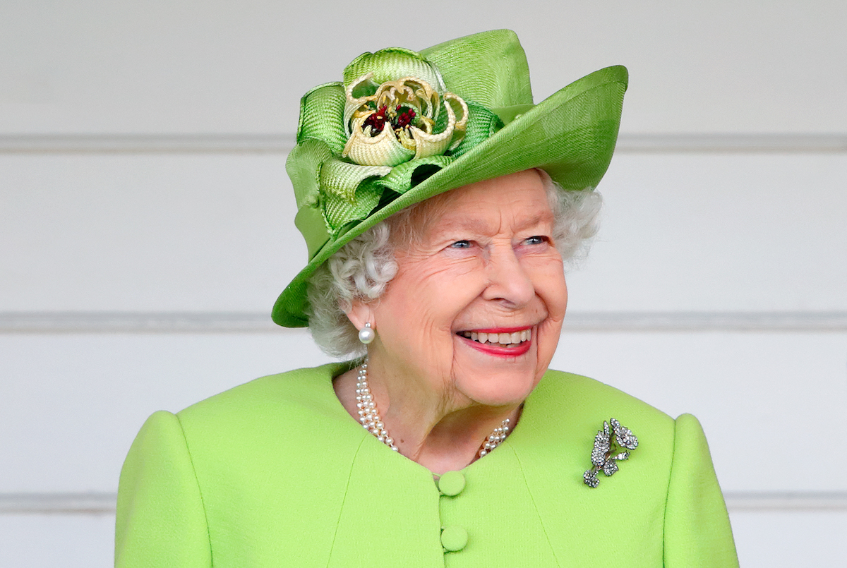 Queen Elizabeth II (wearing her Vanguard Rose Brooch which she received in 1944 from Messrs John Brown and Co. when she launched HMS Vanguard) attends the Out-Sourcing Inc. Royal Windsor Cup polo match and a carriage driving display by the British Driving Society at Guards Polo Club, Smith's Lawn on July 11, 2021 in Egham, England.