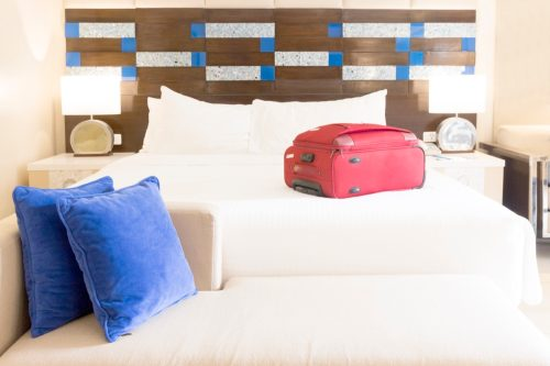 Luggage on a hotel room bed