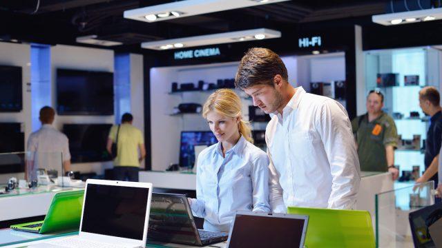 Couple shopping for a computer