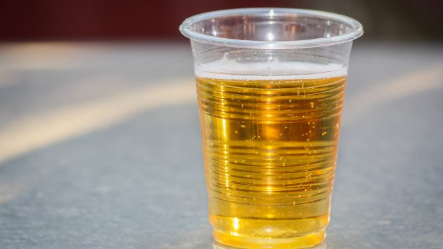 Plastic cup of cheap beer