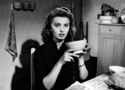 sophia loren holding coffee cup in black and white movie still