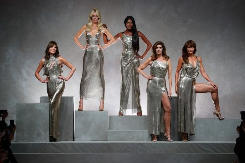 Carla Bruni, Claudia Schiffer, Naomi Campbell, Cindy Crawford, and Helena Christensen modeling for Versace in September 2017