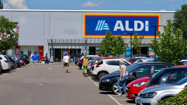 London,UK/June 16,2020:Customers walking on the parking area of Aldi supermarket. Aldi is the common brand of two German based global family-owned discount supermarket chains.