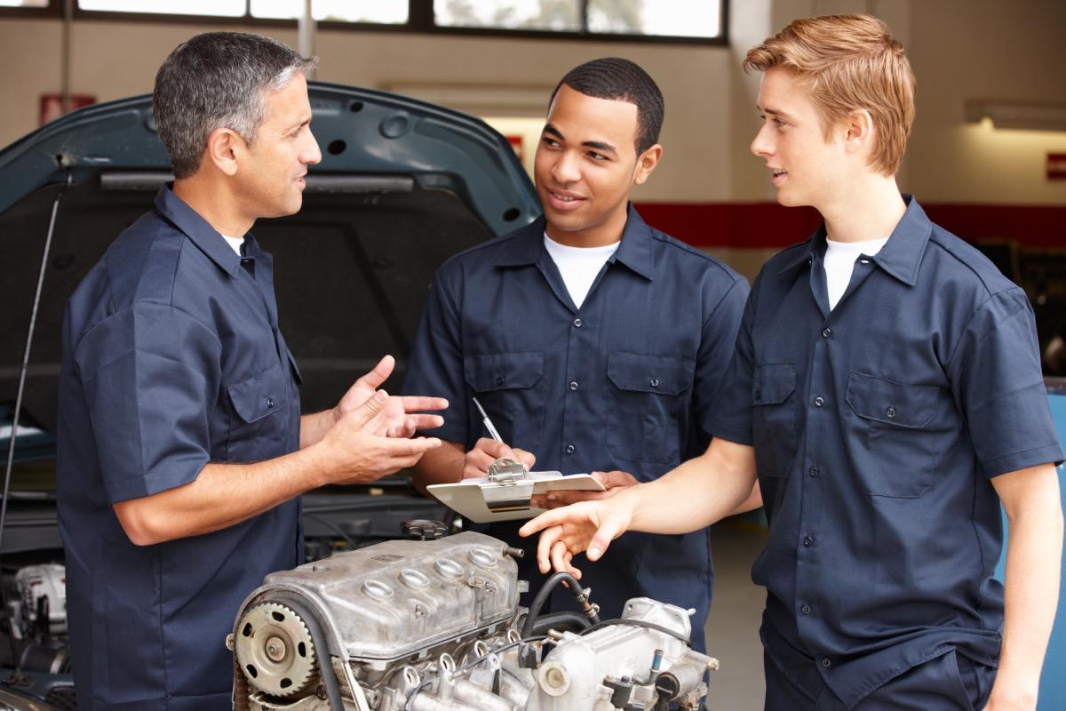 three mechanics talking
