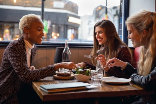 Londoners women eating together at a restaurant