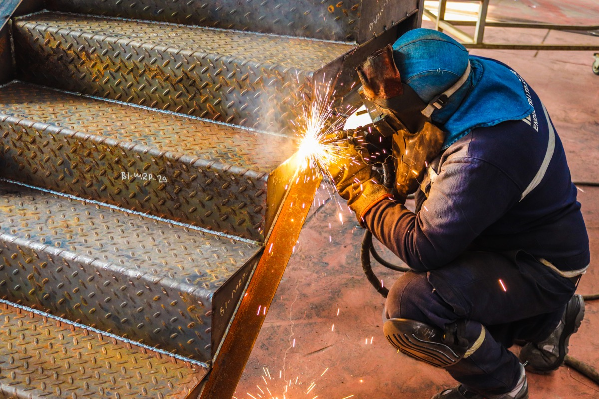 iron worker welding staircase