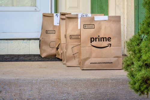 Fort Collins, CO, USA - March 31, 2020: Brown bags with groceries delivered to home from Whole Food Market and ordered through Amazon Prime. Online shopping during coronavirus pandemic.