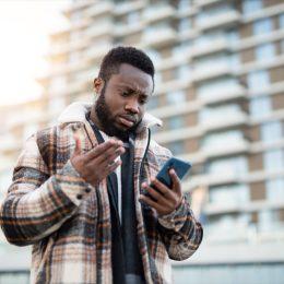 man looking at phone.
