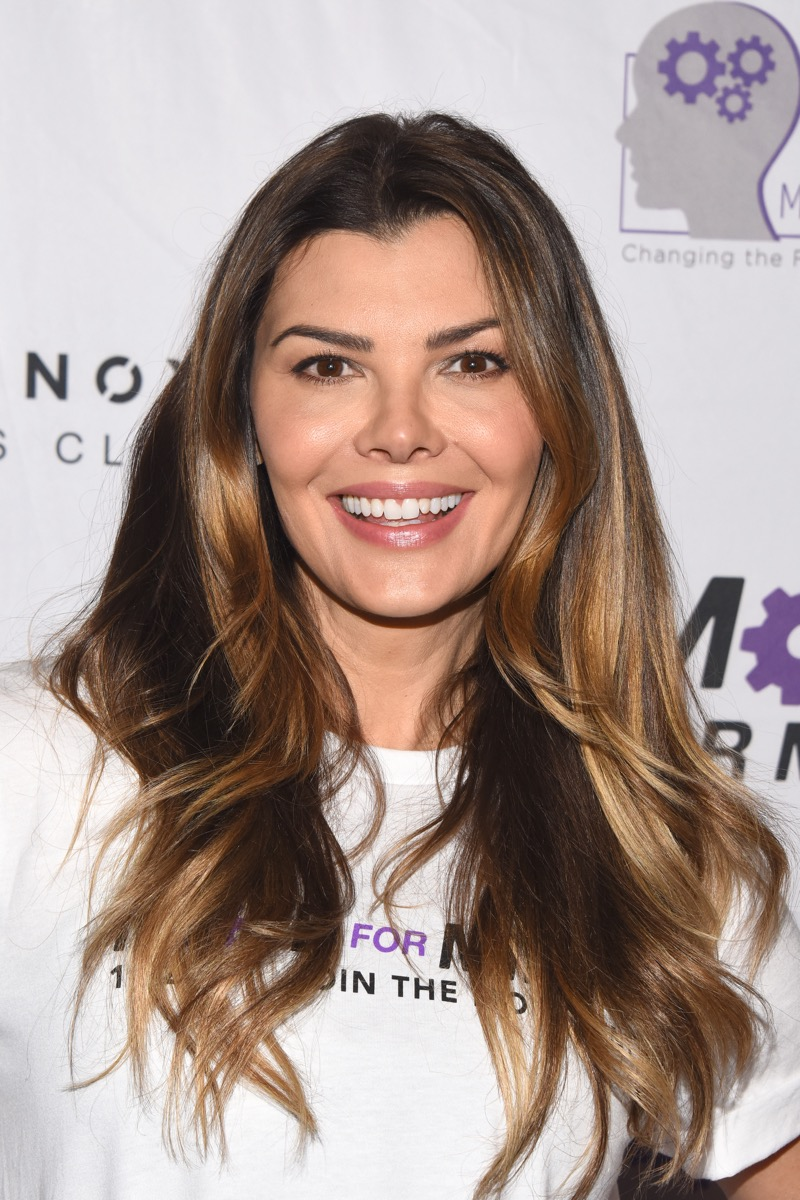 Ali Landry in white t-shirt at charity event red carpet
