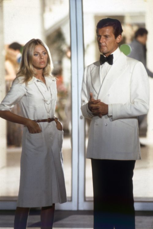 Britt Ekland and Roger Moore on the set of