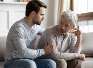 Man comforting agitated father