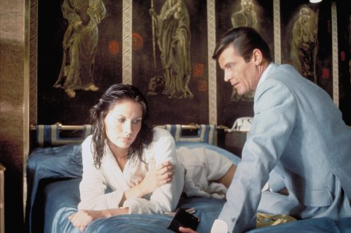Maud Adams and Roger Moore on the set of