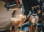 Bartender preparing Irish Cream Liqueur cocktail with shaker