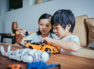 A young boy and girl playing with toys together