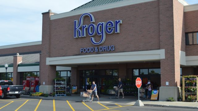exterior of a kroger supermarket during daylight hours