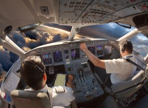 Pilots in the cockpit of an airplane