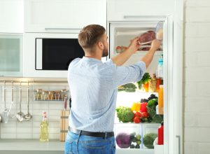 mean removing package of meat from fridge