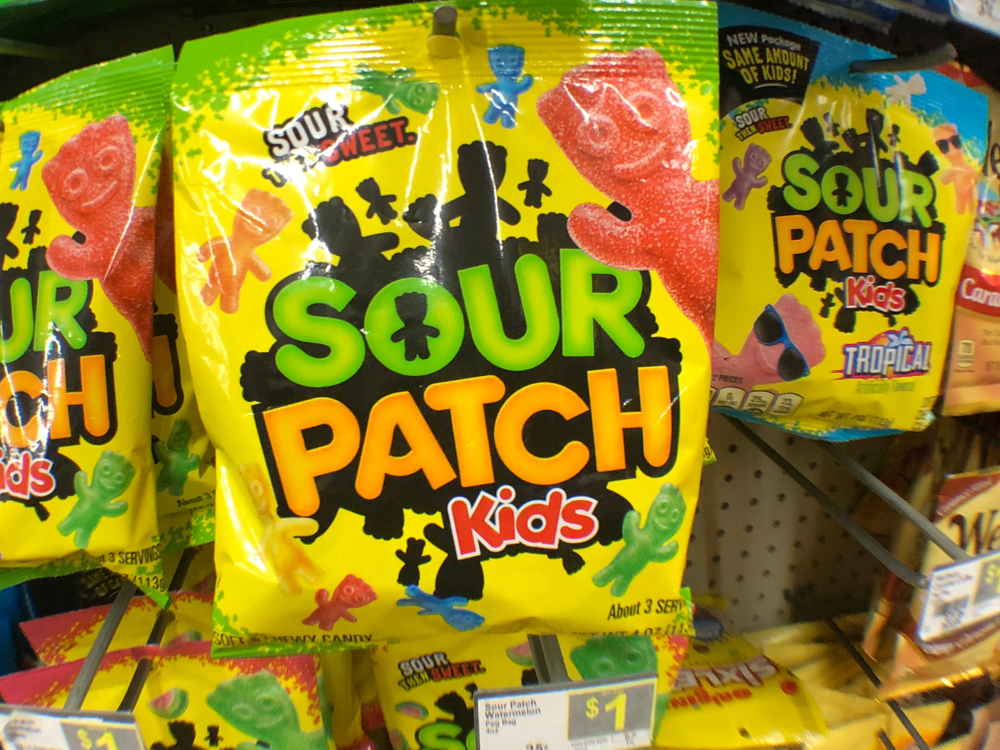 A pack of Sour Patch Kids hanging in the grocery store