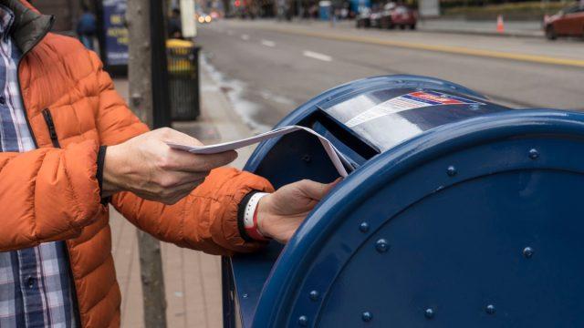 Pittsburgh, PA, USA, 2020-01-11: Man sending letter via postal service