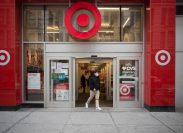 Manhattan, New York. March 24, 2021. A man wearing a mask exits a Target store on 34th street.