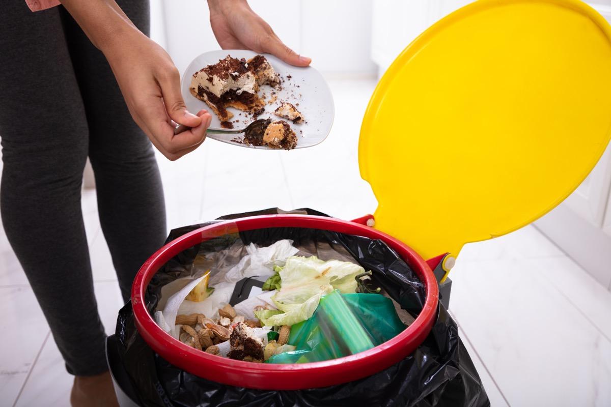 person throwing away trash