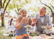 Woman and man eating at a picnic table