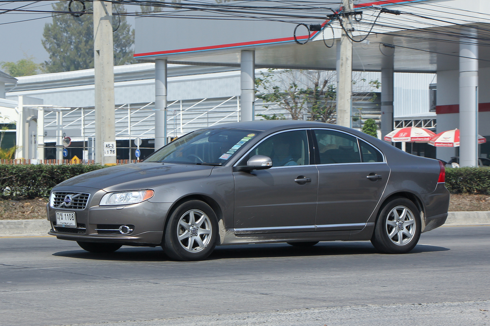 A Volvo S80 sedan driving on a road