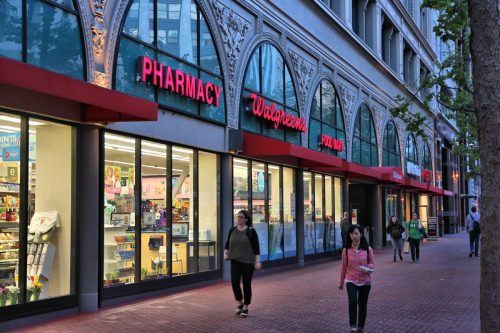 SAN FRANCISCO, USA - APRIL 8, 2014: People walk by Walgreens pharmacy and food mart in San Francisco, USA. Walgreen Co is the largest drugstore chain in the USA by sales.