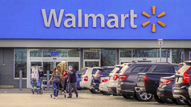 Walmart store shoppers wear corona virus protective masks, Peabody Massachusetts USA, May 2, 2020