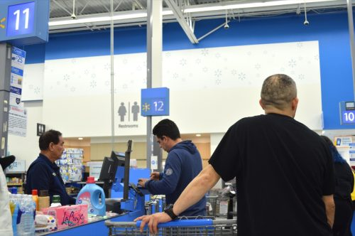 Columbus, Ohio / USA March 30, 2019: Walmart is the nation's largest retail chain.  Consumers line up to pay for their purchases.