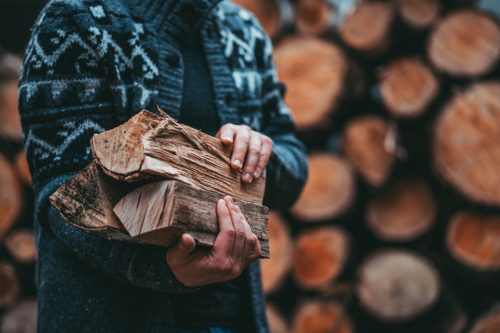 Man holding some firewood