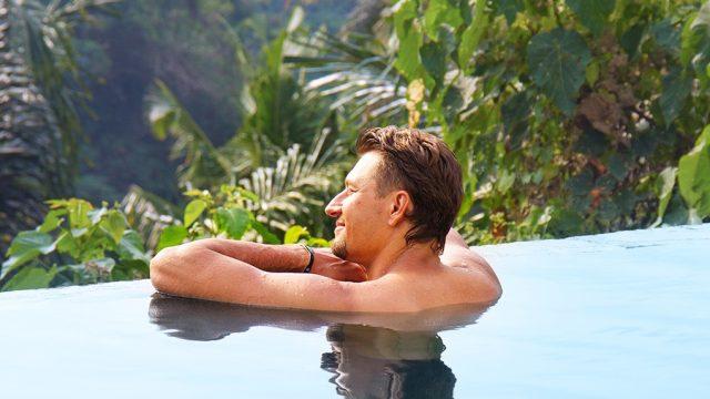 Man in tropical pool