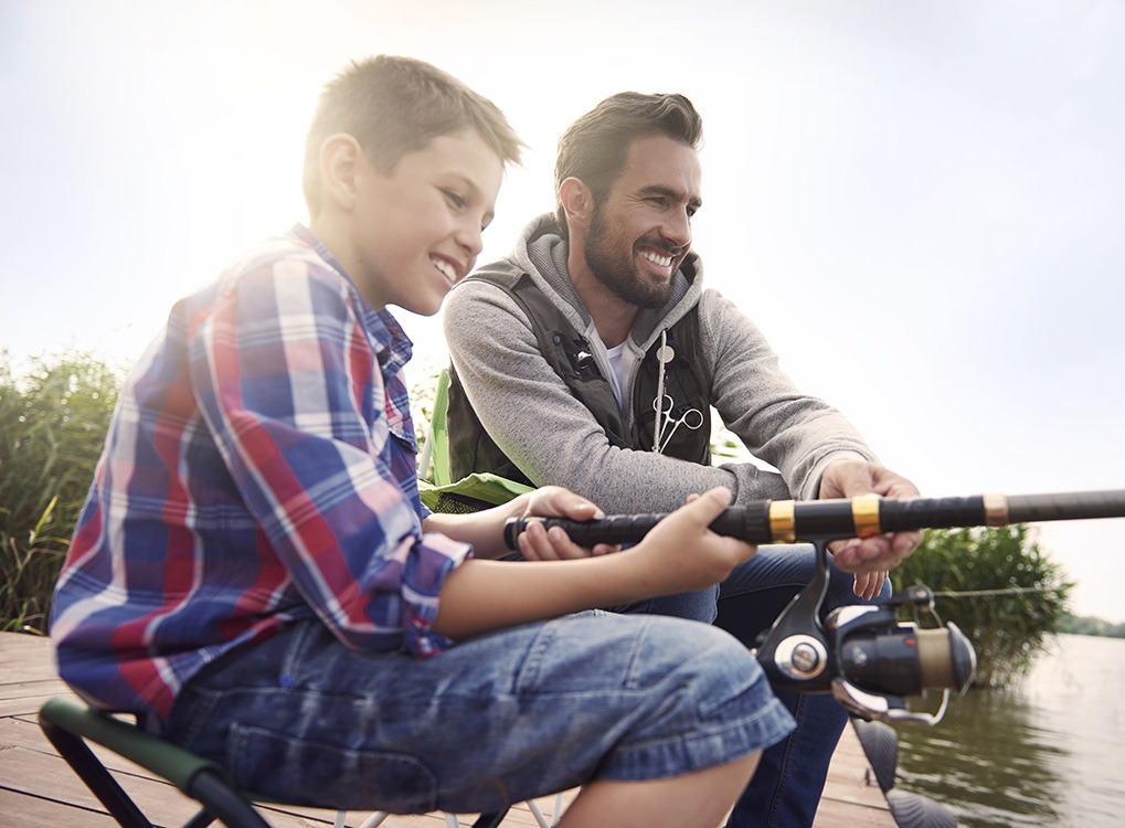 father and son fishing happier