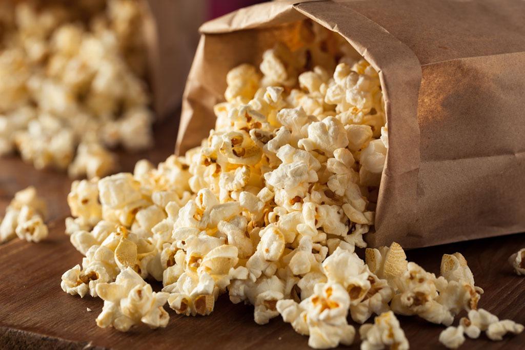 bag of popcorn spilled on table