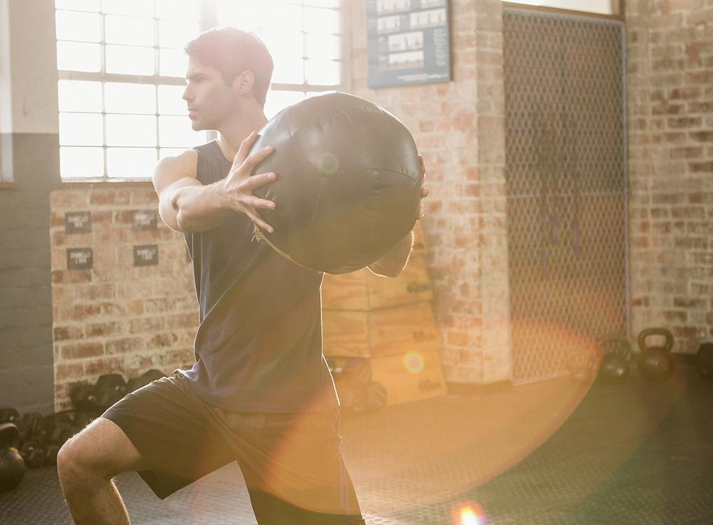 man exercising with a medicine ball