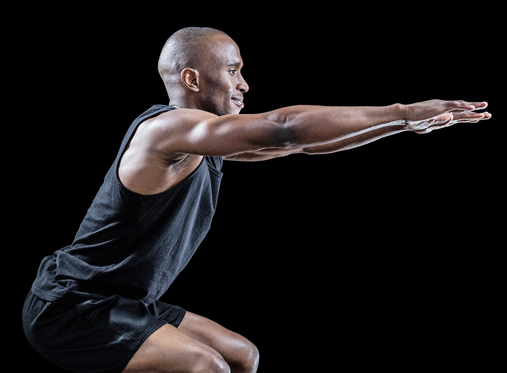 man squatting , Worst Men's Health Myths