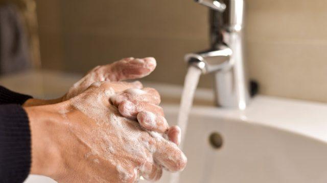 healthy man washing hands