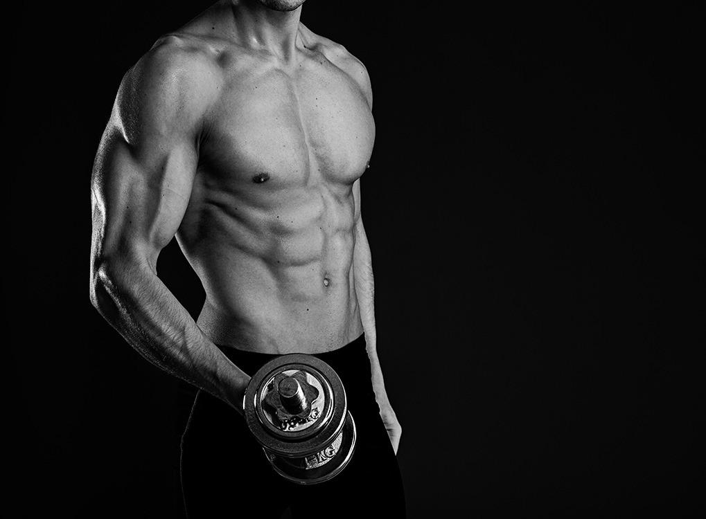 Man Holding Dumbbell boost Metabolism