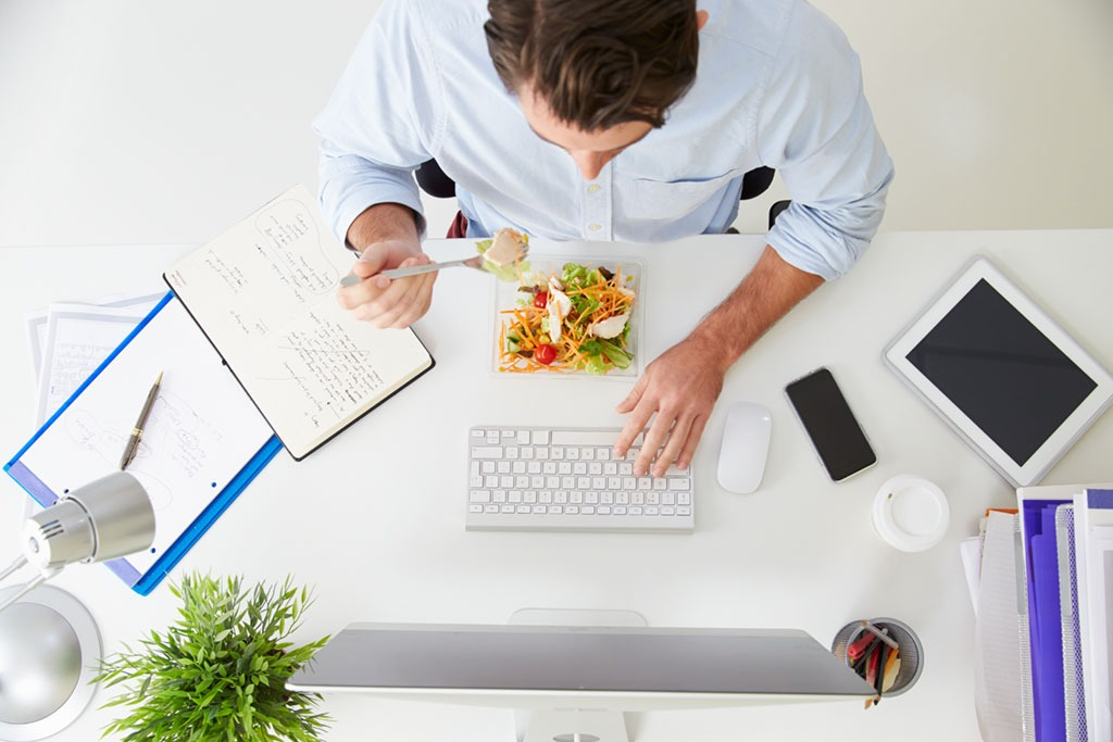 Man working and eating