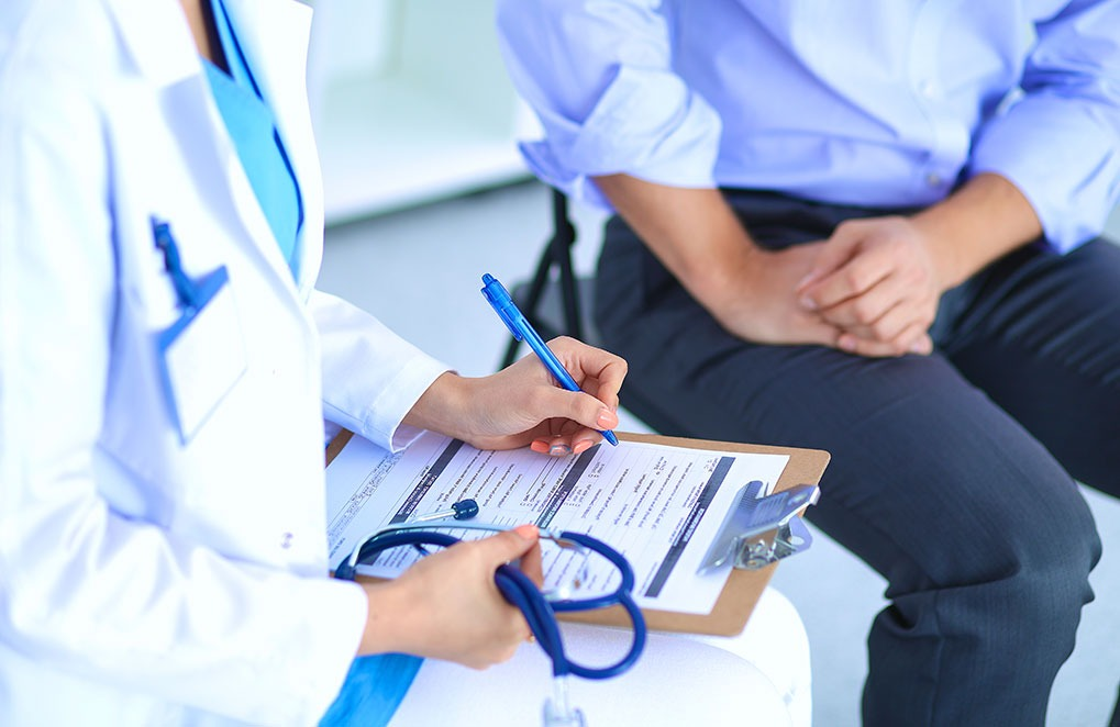 doctor writing on a clipboard, ways your body changes after 40