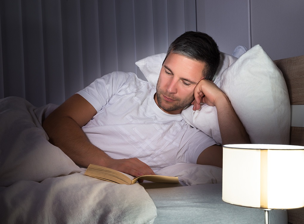 man reading in bed habits after 40