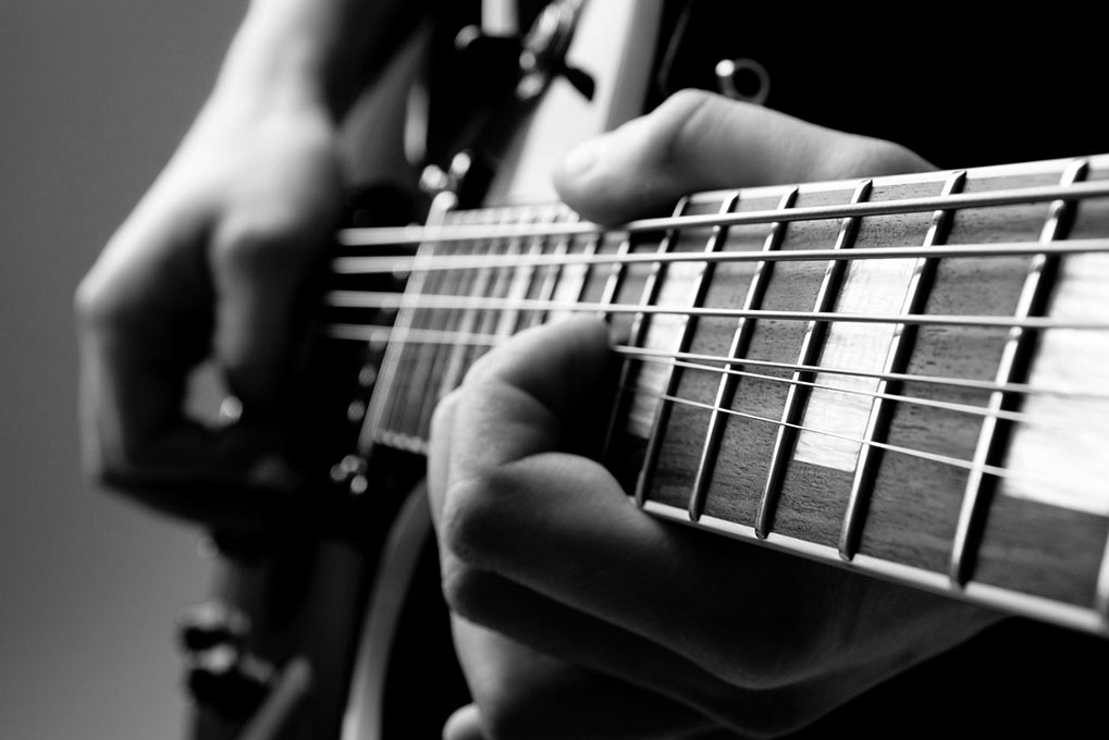 person playing a guitar