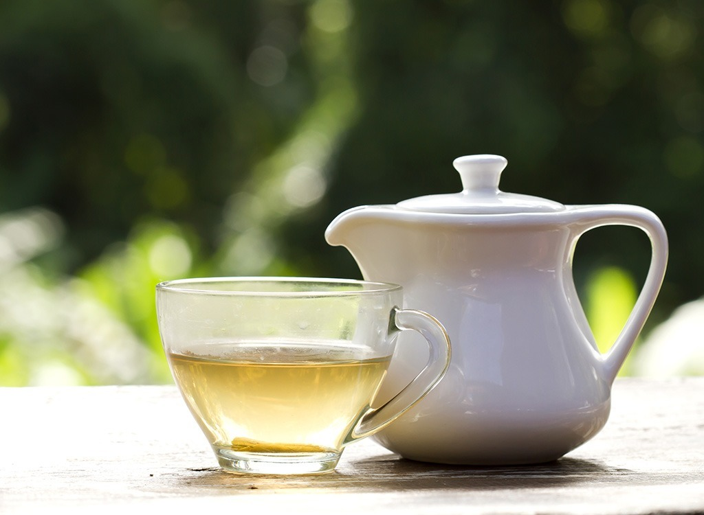 White tea in cup and teapot