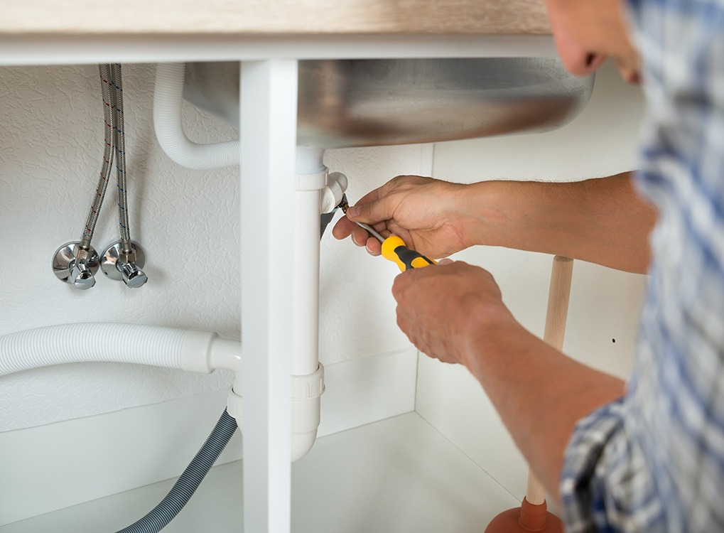 man fixing sink small acts of kindness