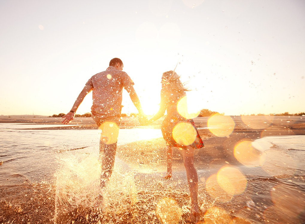 couple on beach happier