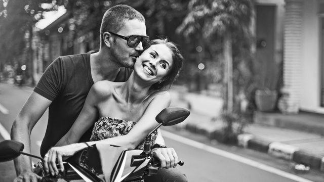 discounts couple on a motorcycle