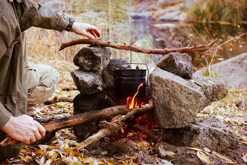 man campfire marshmallows