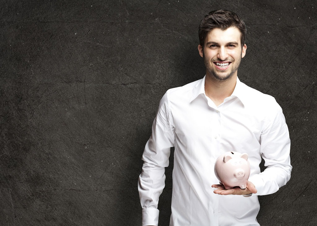 man with piggy bank saving money