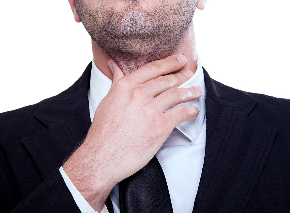 Man is Having Trouble Swallowing Signs of Poor Health over 50